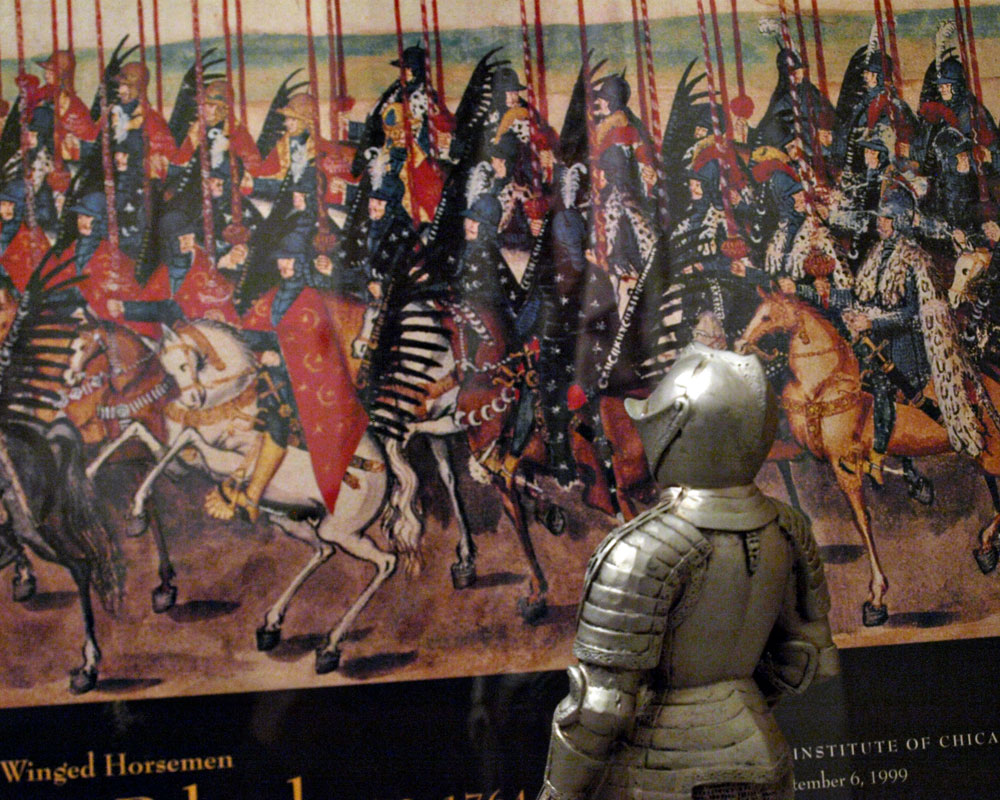 knight standing in front of picture of polish knights