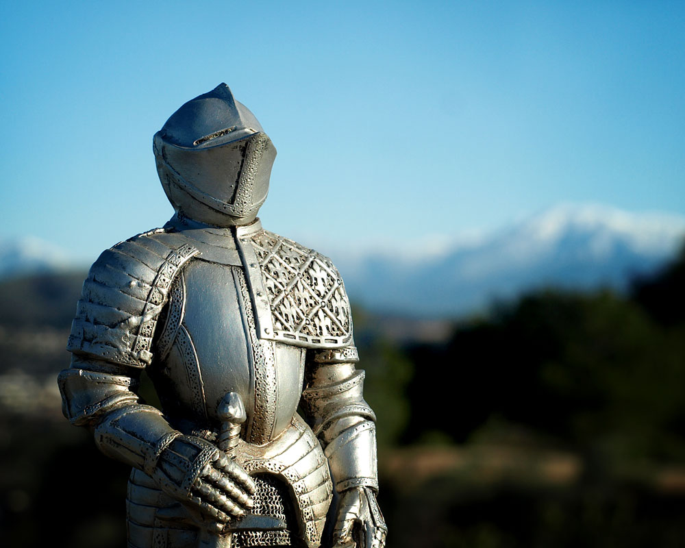 knight figurine with mountains in background