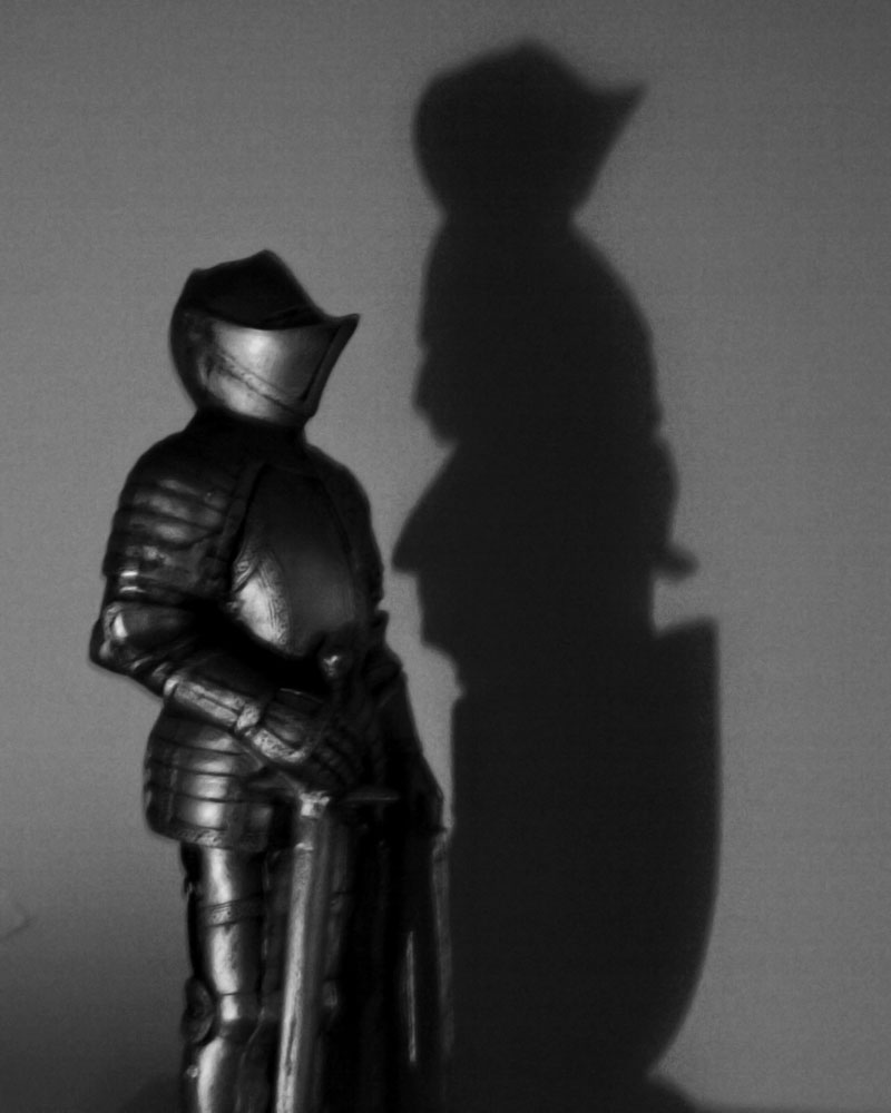 knight figurine with shadow