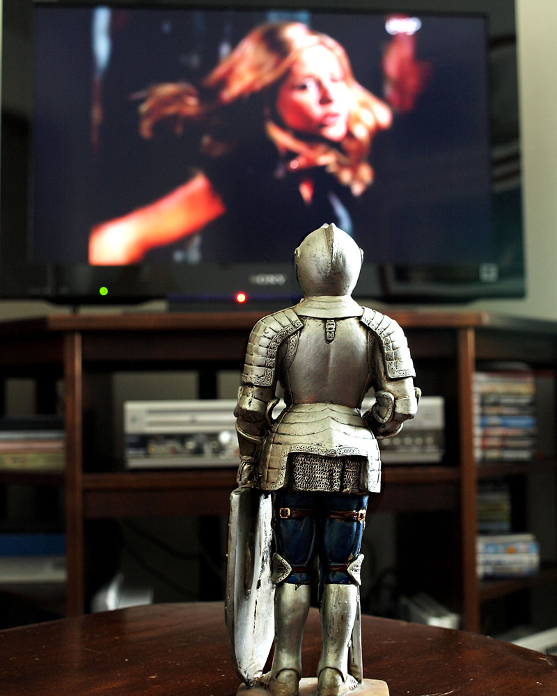 knight figurine in front of tv