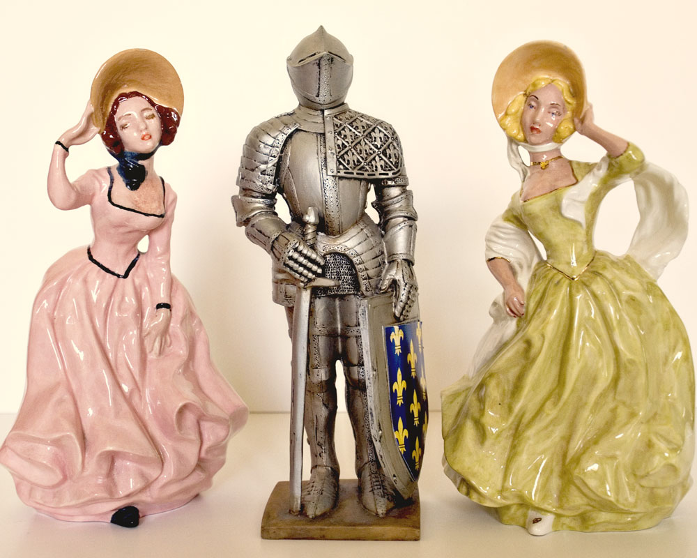 knight figurine with two porcelain ladies