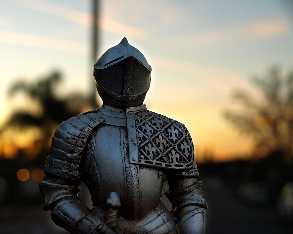 knight figurine with sunset