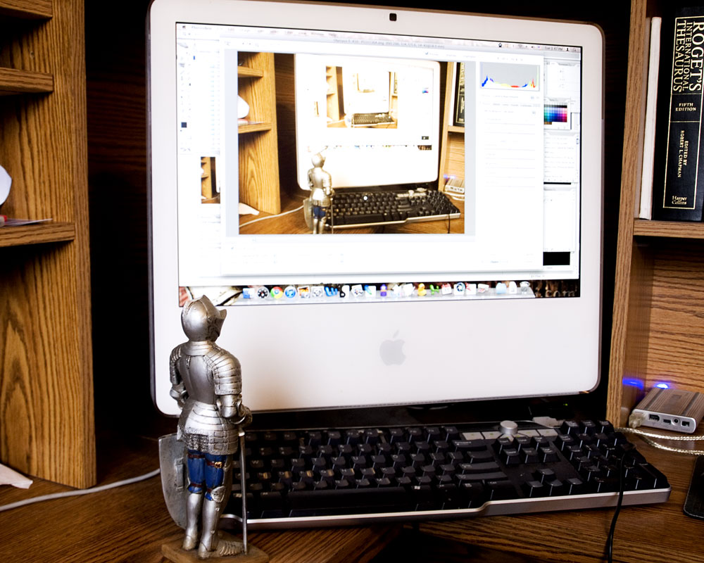 knight figurine in front of recursive computer screen