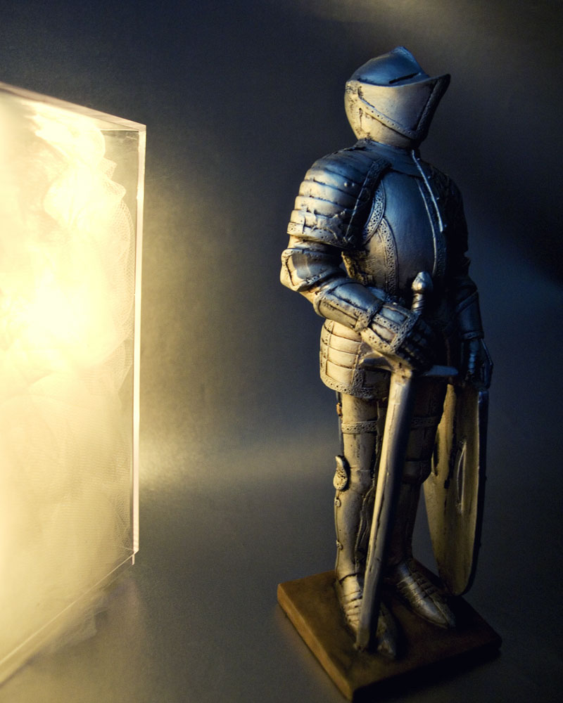 knight standing in front of panel of light
