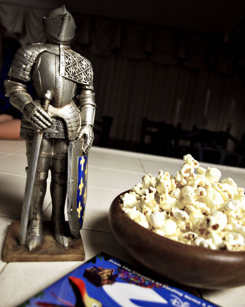 knight figure on counter next to bowl of popcorn