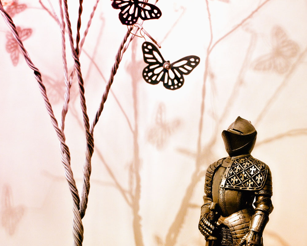 knight figure with small wire tree and paper butterflies