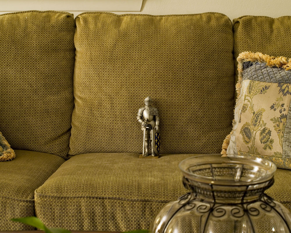 knight figure sitting on sofa