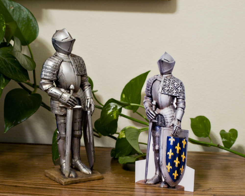 knight figure posing with smaller paperdoll version