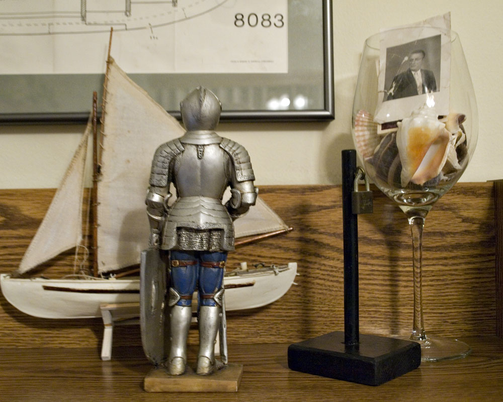 knight figure on shelf with toy boy