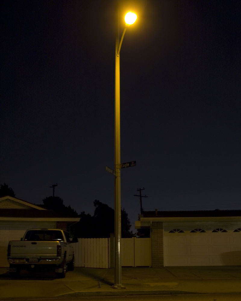 knight figure standing under lightpole