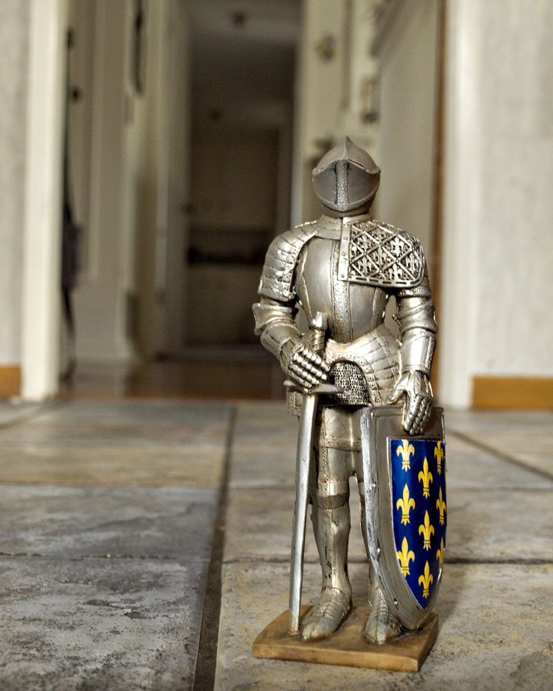 knight figure standing on floor in entryway