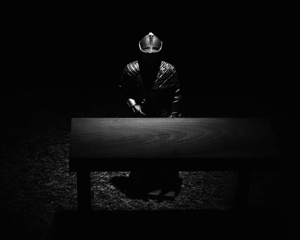knight behind table in black and white