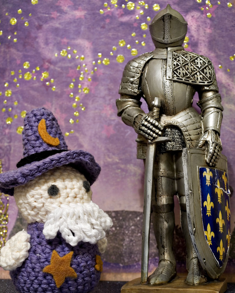 knight figure posing with crocheted wizard