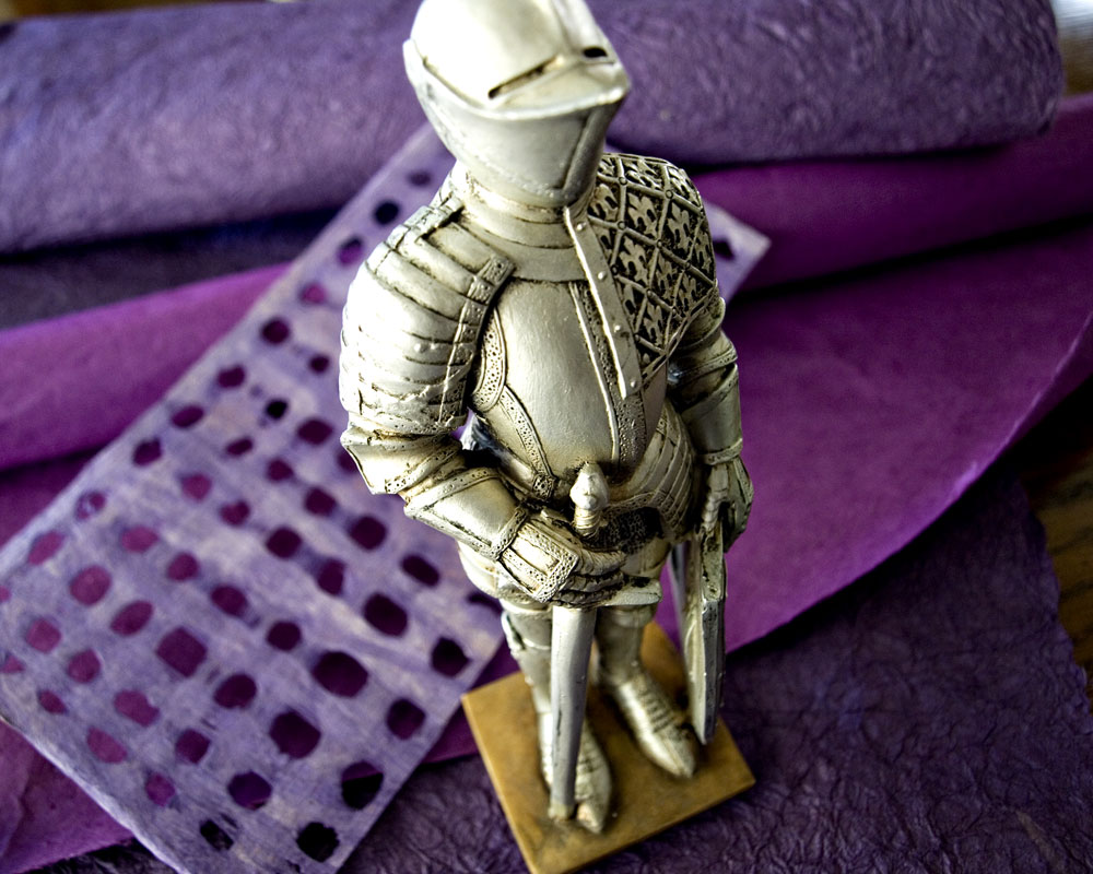 knight posing with purple paper