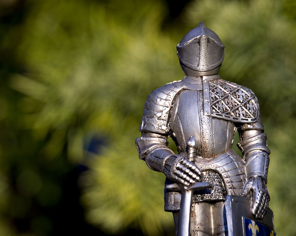knight figure against green bokeh background