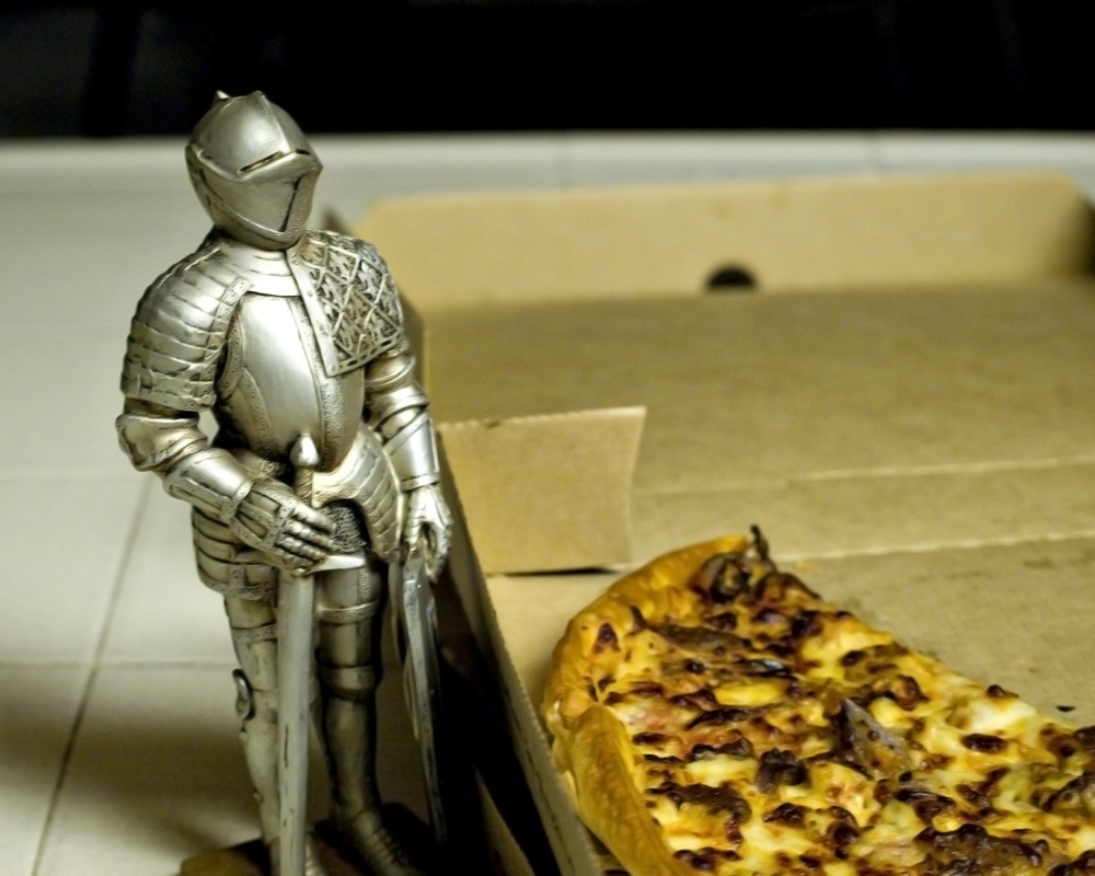 knight figure standing by pizza
