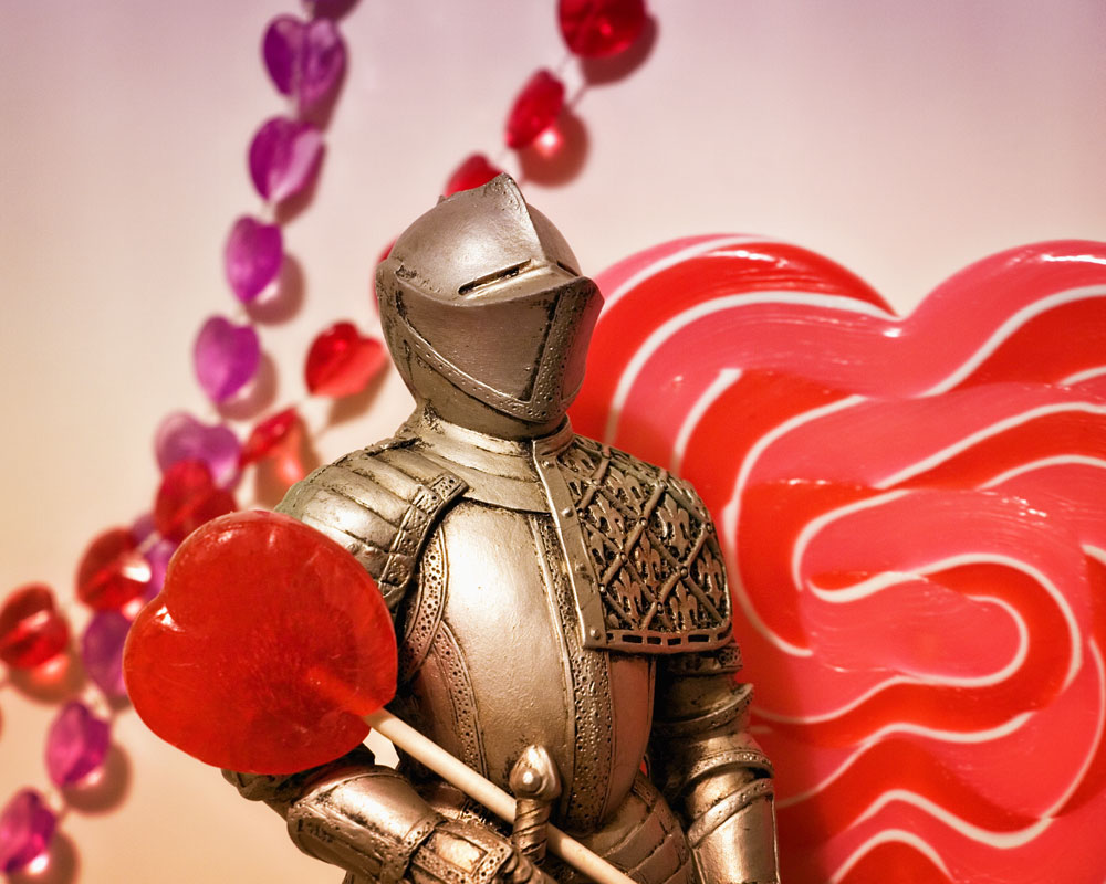 knight figure with red lollipop against heart background