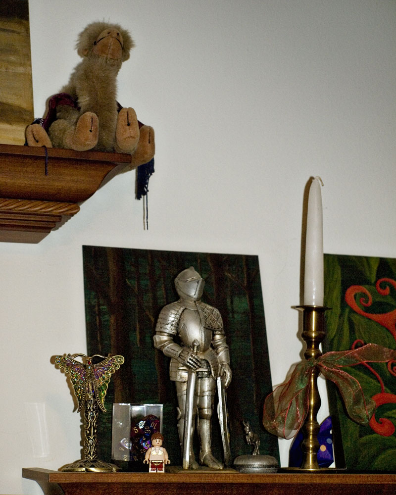 knight figure standing on shelf with various items