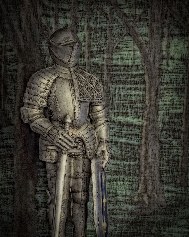knight figure standing in front of painting of forest