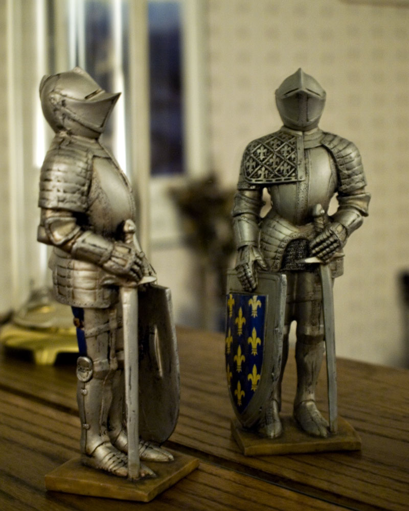 knight figure posing with his own reflection