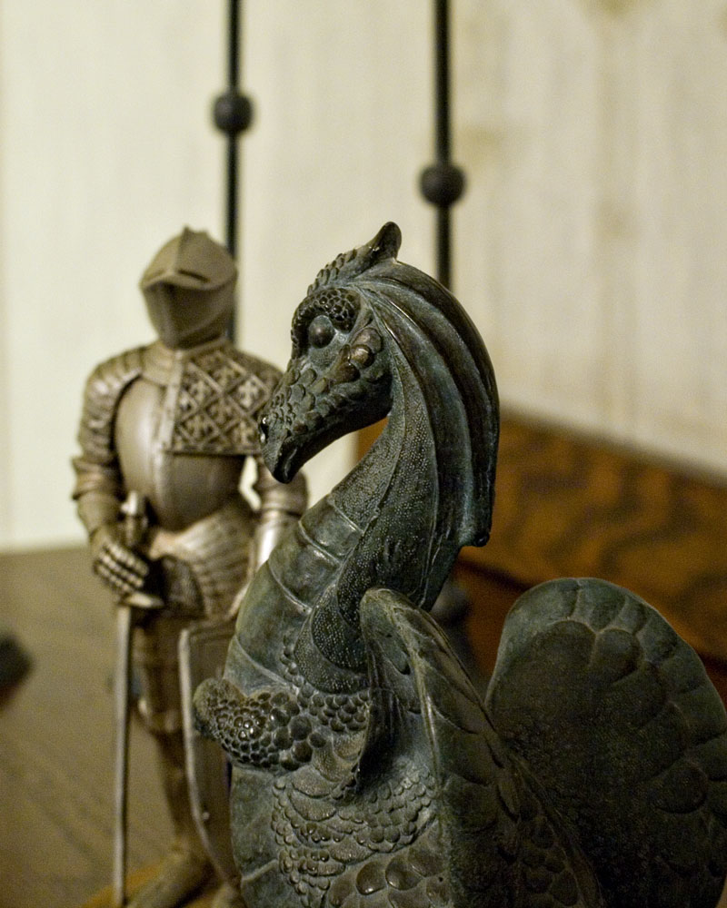 knight figure with small dragon figure