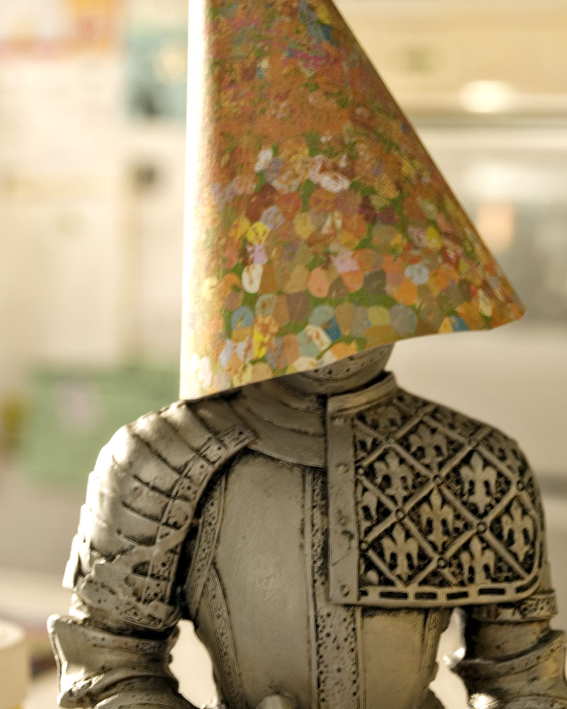 knight figure with paper cone over head