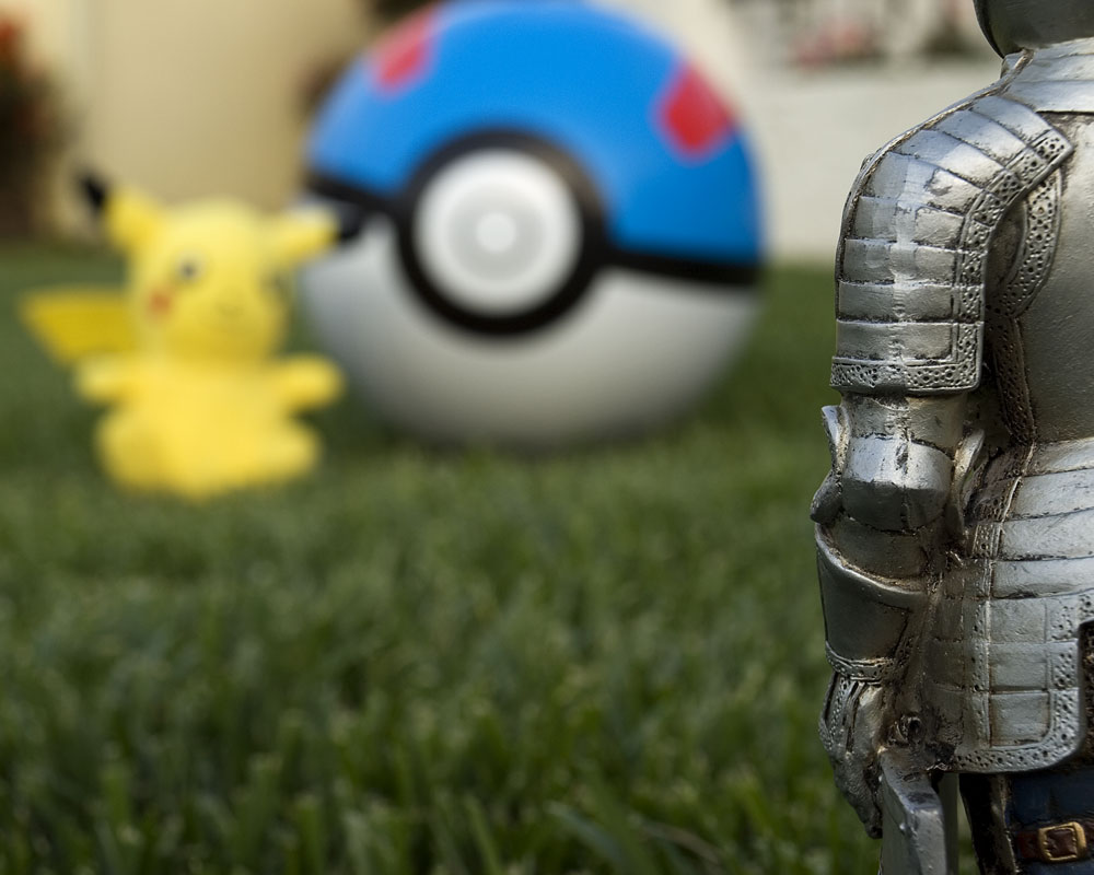 knight figure with pikachu and pokeball